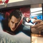 Taking selfie behind a picture